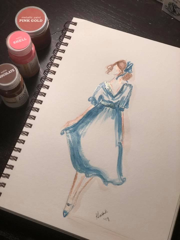 Girl in blue dress with paint